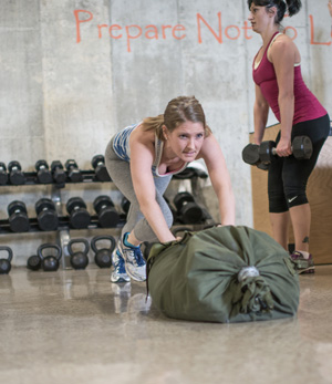 woman pushing a heavy bag