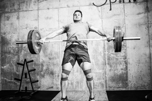 man lifting heavy weights on a barbell