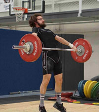 picture of Brandon Thompson, BS, USAW-L1SP lifting a barbell with weights